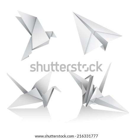 paper figures of birds and airplane on a white background