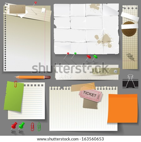 Paper pages, sheets of paper and clips over gray background