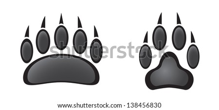 paw prints in black and white - stock vector