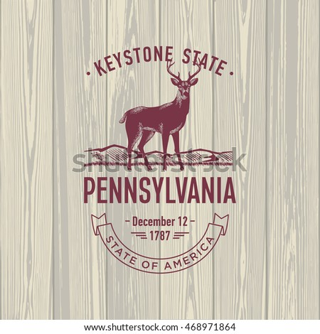 Pennsylvania, Keystone State, stylized emblem of the state of America, deer, on wooden background