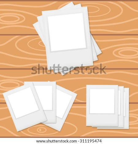 Photo frames on wooden background in vector. - stock vector