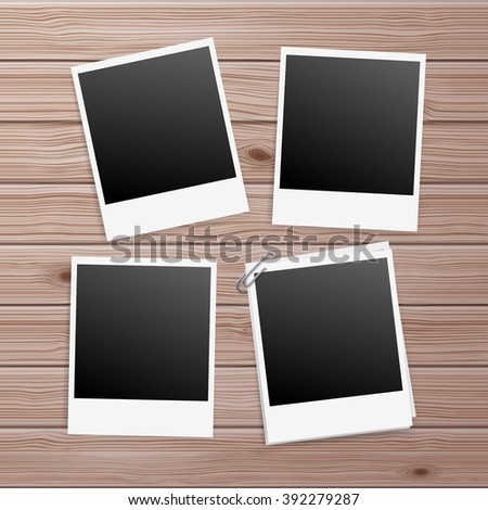 Photo Frames on Wooden Table with Paperclip