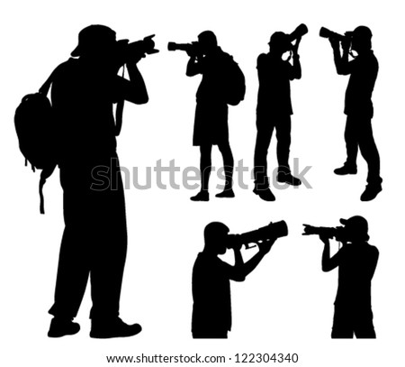 photographers with telephoto lens silhouettes