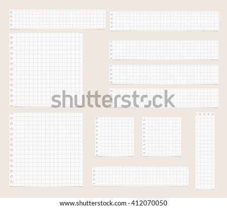 Pieces of cut out white squared notebook paper are stuck on light  brown background