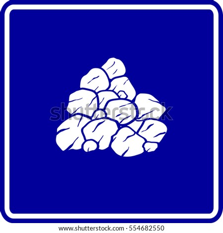 pile of rocks or coal sign