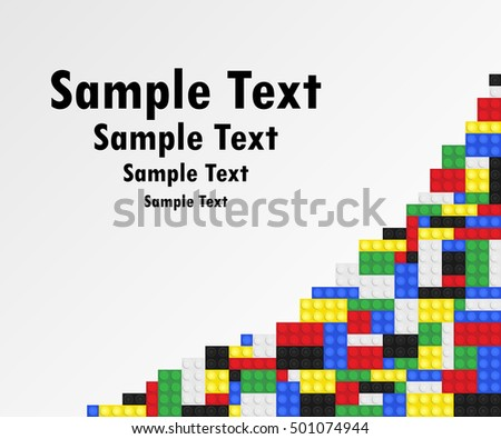 Plastic toy building bricks background. Colorful bricks on right hand side of blank copy space