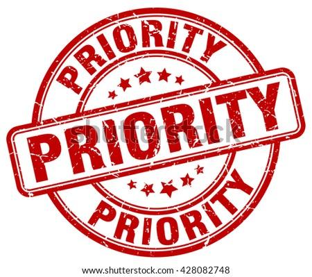 priority red grunge round vintage rubber stamp.priority stamp.priority round stamp.priority grunge stamp.priority.priority vintage stamp. - stock vector