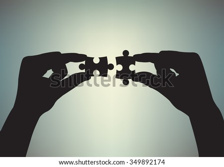 Puzzle in human hands. Teamwork concept.