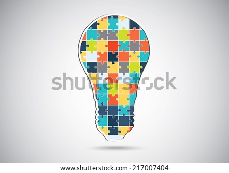 Puzzle piece light idea bulb. illustration over a white background - stock vector