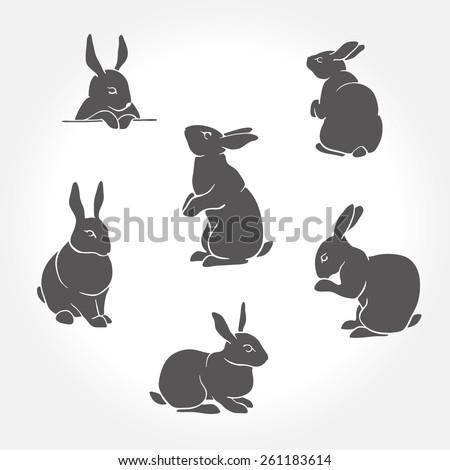 Rabbit black silhouettes - stock vector