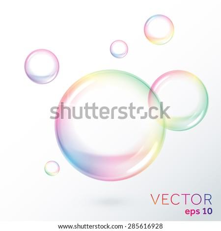 Rainbow transparent soap bubbles. Vector illustration - stock vector