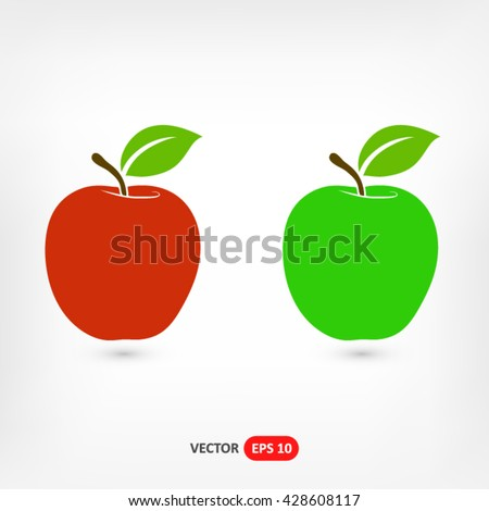 Red and green apples on a gray background