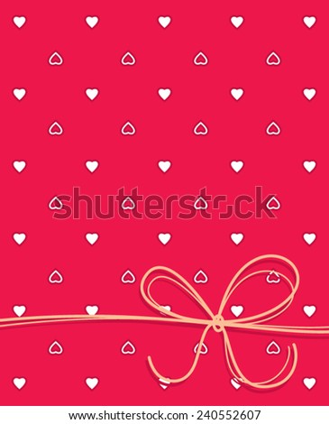 Red notebook cover or greeting card with hearts and ribbon.