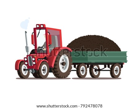 Red tractor with trailer. A pile of manure in the trailer.