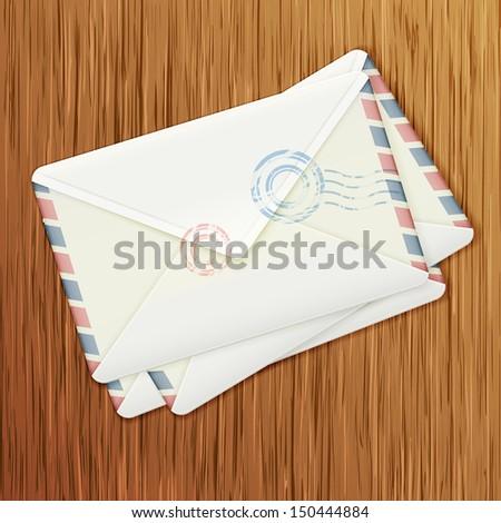 Retro envelopes on wooden background - stock vector