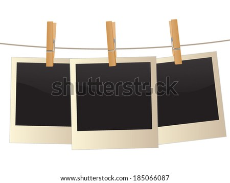 Retro photo frame hanging on a rope held by clothespins, isolated on white background,