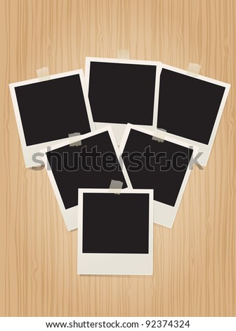 retro photo frames on wooden background - stock vector