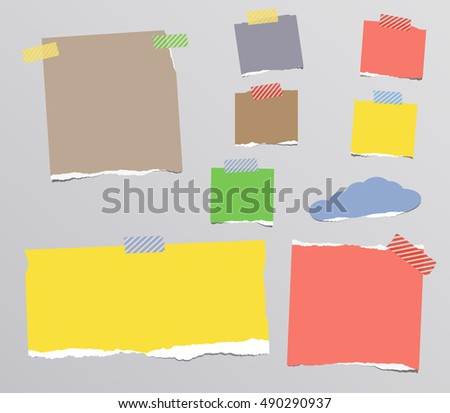 Ripped colorful notebook, note paper stuck on gray background