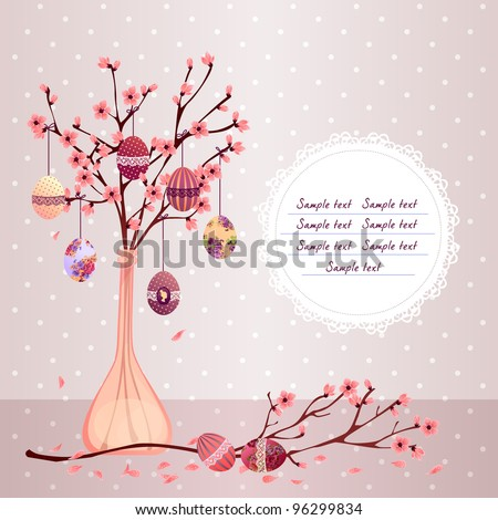 romantic easter greeting card with painted eggs and cherry blossom
