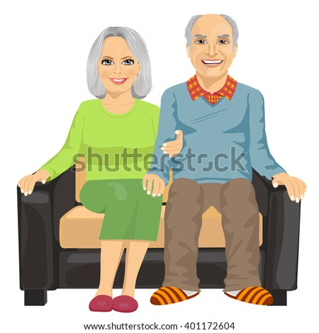 Romantic elderly couple sitting close together on a sofa