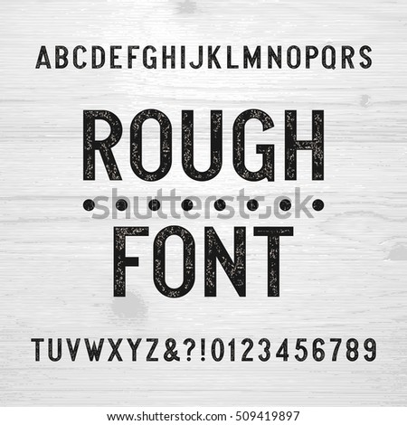 Rough alphabet font. Scratched type letters and numbers on a wooden background. Retro stock vector typography for your design.