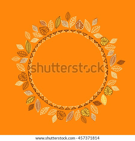 Round frame with autumn leaves on an orange background.