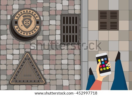 Round steel sewer manhole on the cobblestone road. Cast iron drain cover on the street. Vintage triangle cast iron hatch cover. Person hold smart phone walking along the pavement. Vector illustration
