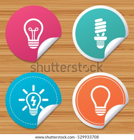 Round stickers or website banners. Light lamp icons. Fluorescent lamp bulb symbols. Energy saving. Idea and success sign. Circle badges with bended corner. Vector