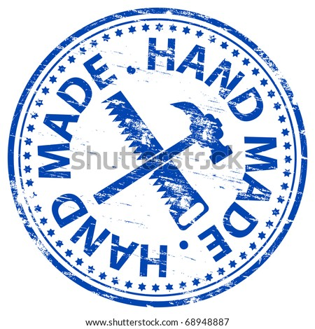 "Rubber stamp illustration showing ""HAND MADE"" text"
