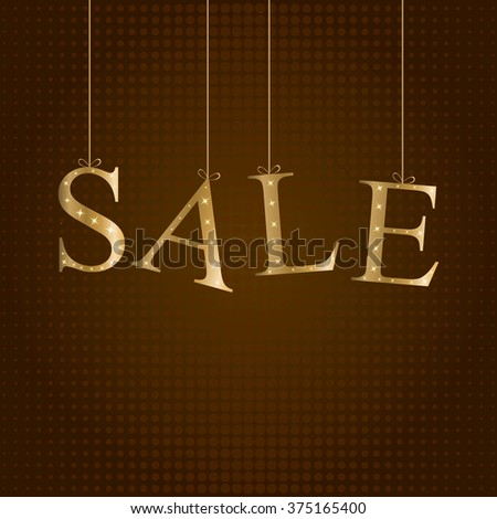 Sale. Golden hanging letters on brown background