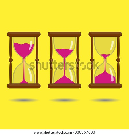 Sandglass with pink sand on yellow background