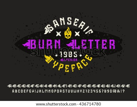 Sanserif font with flame initial letter and spray texture. Typeface design for t-shirt. Color print on black background - stock vector
