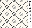 Seamless animal pattern of paw footprint and bone. Endless texture can be used for printing onto fabric, web page background and paper or invitation. Dog style. White and black colors. - stock vector