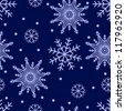 Seamless background with snowflakes on dark blue - stock vector