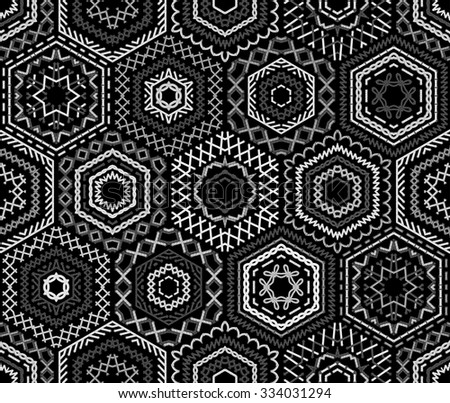 Seamless black and white embroidery pattern. Ethnic textile boundless background. Vector high detailed stitches. White embroidered hexagons on black background.  - stock vector