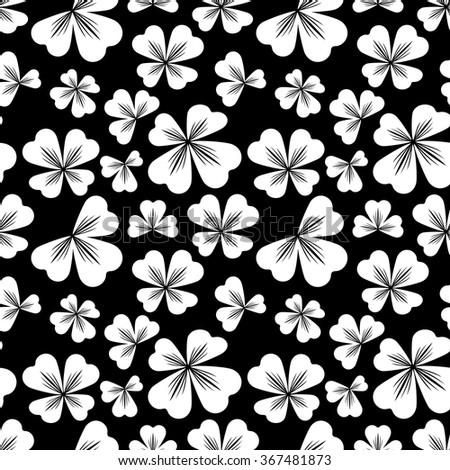 Seamless black and white pattern with shamrock silhouette