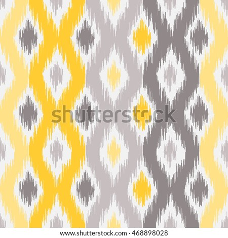 Seamless geometric pattern, based on ikat fabric style. Vector illustration.