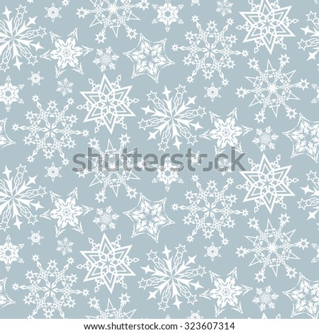 Seamless pattern from snowflakes on a gray background