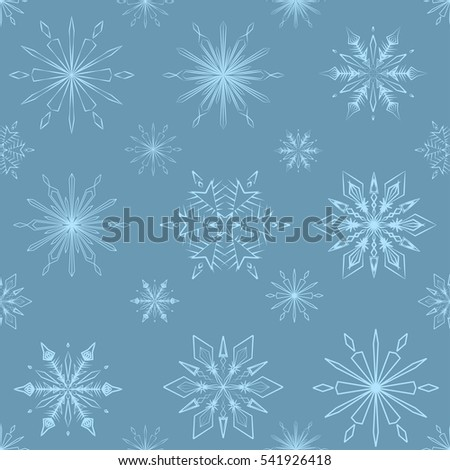 Seamless  pattern of  snowflakes on a dark blue background
