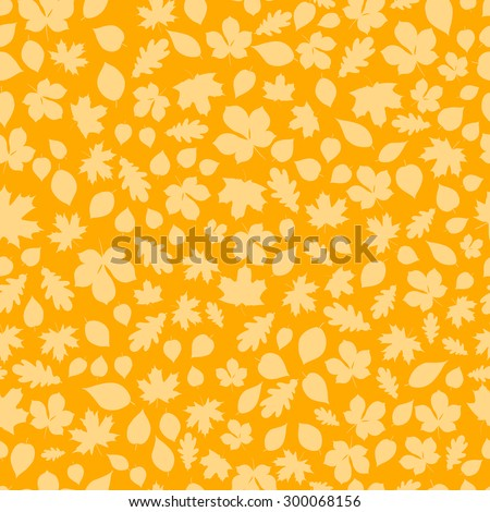 Seamless pattern of yellow autumn leaves on brown background