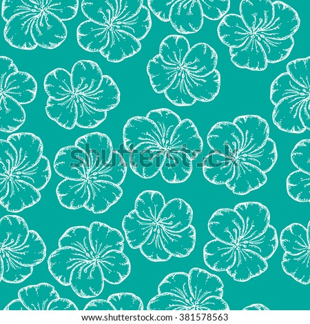 Seamless pattern with hand drawn flowers. Doodle style. Tropical flowers on blue background. Wrapping paper.