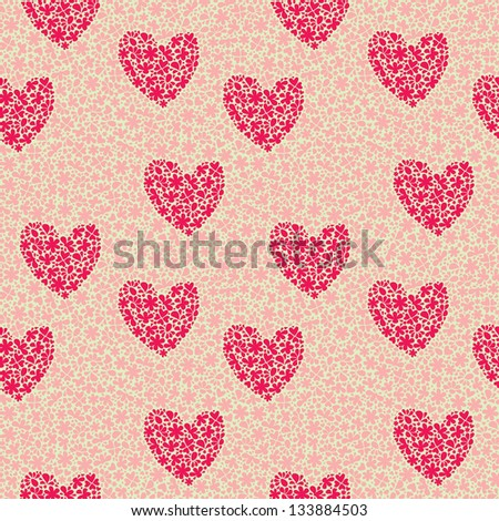 Seamless pattern with hearts of flowers on a background of flowers
