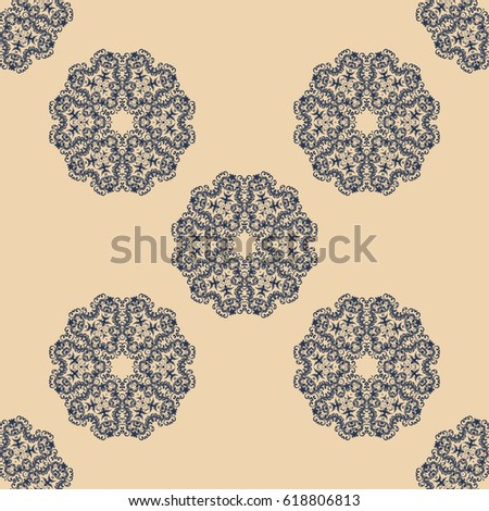 Seamless tan and blue ornament on background. Wallpaper pattern