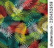 Seamless tropical pattern with stylized coconut palm leaves. - stock