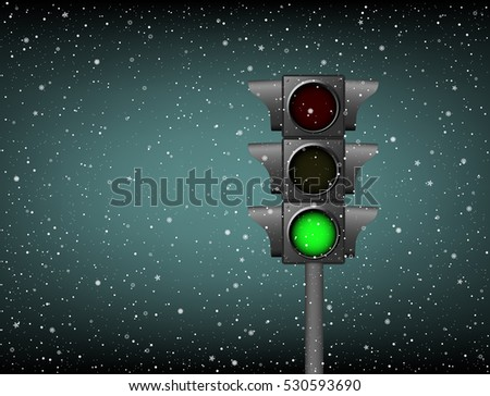 Semaphore with included green on a background of snow. Winter abstract landscape