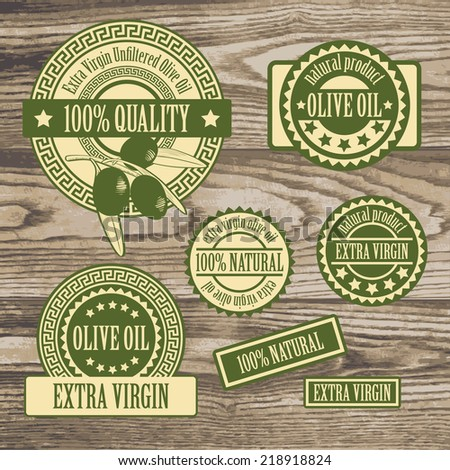 set collections of labels for olive oil, olive branch products isolated on a rustic wooden texture background. vector illustration  - stock vector