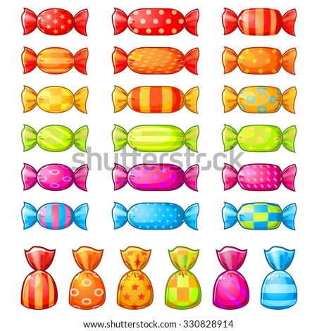 Set of assorted festive wrapped candies isolated over white