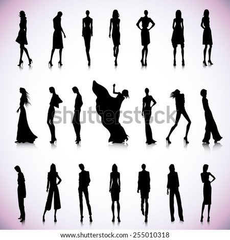 Set of black silhouettes of high fashion clothed women - stock vector