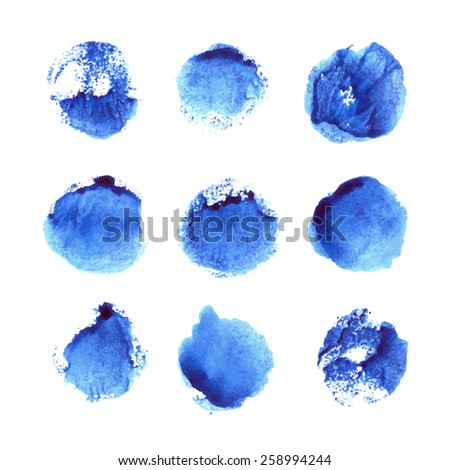 Set of 9 blue circles painted in watercolor. Vector template for your design.