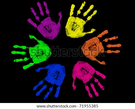 Set of colorful hand prints isolated on black background - stock vector